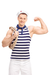 Vertical shot of a male sailor showing his bicep