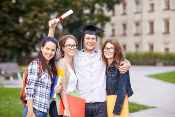 happy teenage students with diploma and folders