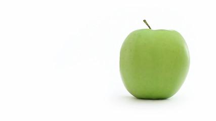 Green apple bitten