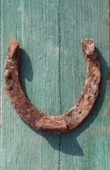 rusty horseshoe on wood log