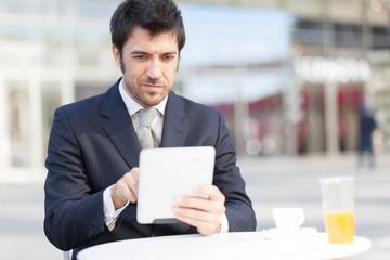 Businessman using his digital tablet
