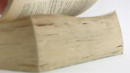 Man's hand scrolls a Book