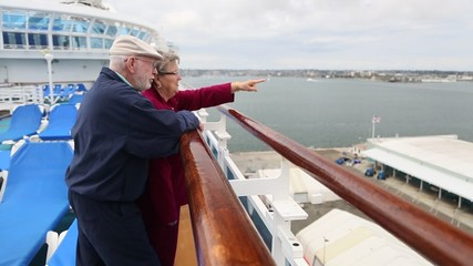 Senior Couple Looking Over Railing of Cruise Ship