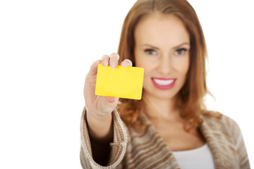 Happy woman with blank card.
