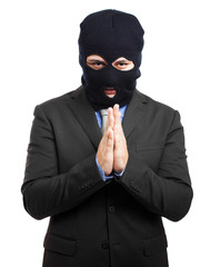 corruption concept : man in business suit and black mask