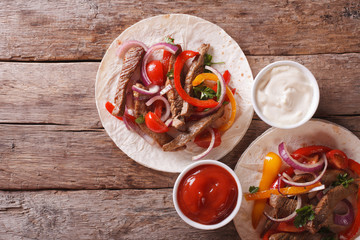 tortillas with meat, vegetables and sauce horizontal top view