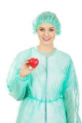Female doctor with heart model.