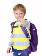 Boy with reflective vest shows thumb up
