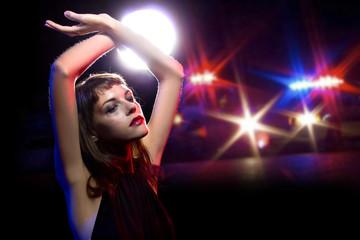 Drunk female holding her hands up being arrested