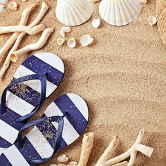 summer shoes on sand. copy space background
