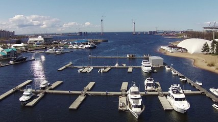 Flying Above Yachts at a Marina, aerial view