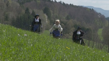Fantasy Adventure Group running on meadow – Slow Motion