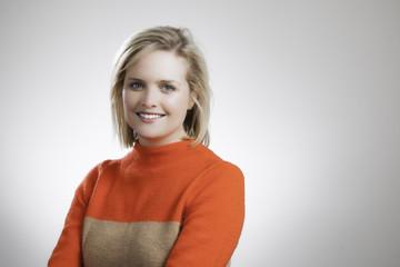 Young Pretty Blonde Orange Sweater Corporate Headshot