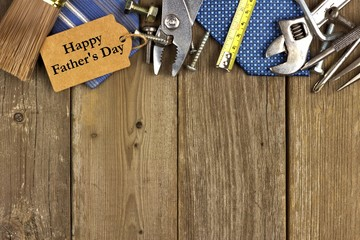 Fathers Day gift tag with top border of tools and ties on wood