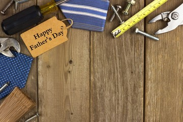 Fathers Day gift tag with border of tools and ties on wood