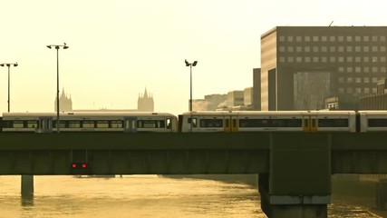Trains are approaching on a railway bridge in London