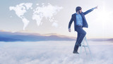 Conceptual image of businessman over the cloud world map