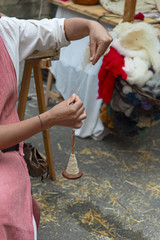 woman intent on making a piece of string