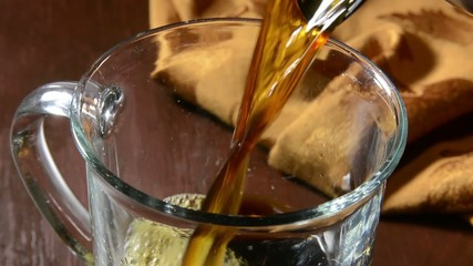 Closeup of coffee pouring into a cup