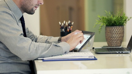 Businessman hands working with tablet computer