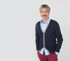 Handsome trendy mature man on grey background