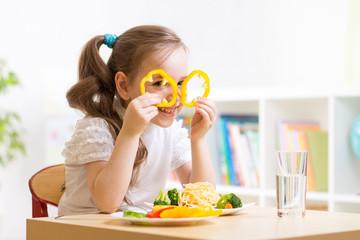 child eating in kindergarten