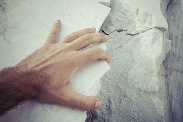 Hand on marble