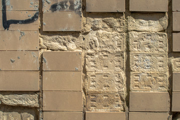 old concrete wall which is partly covered with ceramic tiles