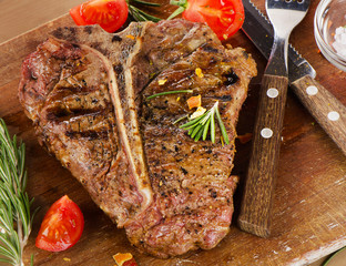 Steak with Herbs on  a rustic wooden table