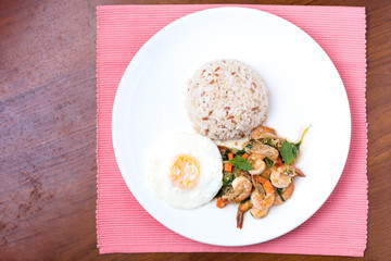 Shrimps with chili, basil, sunny-side-up, stream rice.
