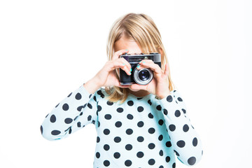 Girl with an old camera