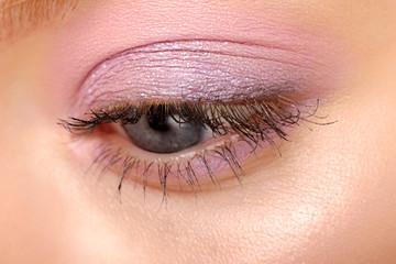 Macro image of human eye with make-up