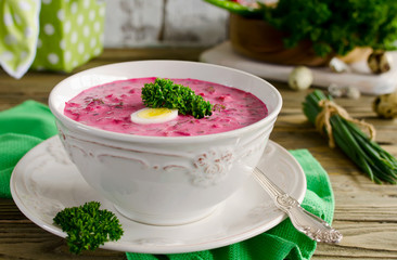 Cold beet soup with egg, cucumber, potatoes and greens