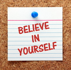 Believe In Yourself message on a cork notice board