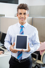 Manager Holding Tablet Computer At Call Center