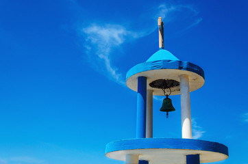 Typical blue-white church tower (steeple) with bell, Greece