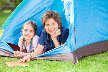 Happy Siblings Lying In Tent