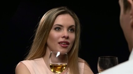 Blonde woman holding glass of wine. Close up, Slow motion