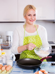 Smiling girl dough with whisk