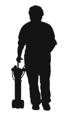 elderly man in silhouette with portable oxygen unit