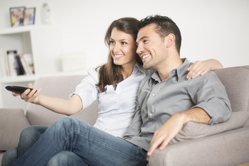 Young couple watcing tv