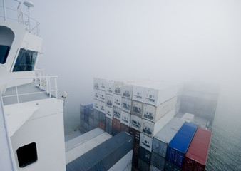 cargo ship navigating through misty English Channel