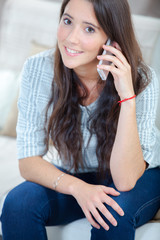 Young brunette making a call