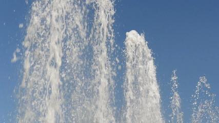 Slow motion fountain. Water splash in slow motion.