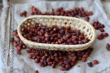 Dried rose hips on a linen background