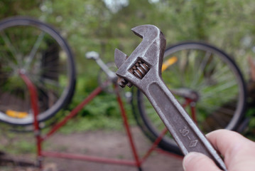 adjustable wrench in front of bike