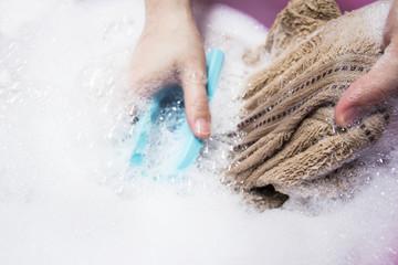 Woman washing towel
