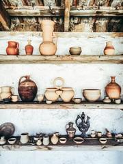 vintage ware on the wooden shelves. vertical