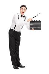 Joyful movie director holding a clapperboard