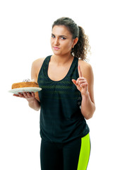 athletic girl holding a cake